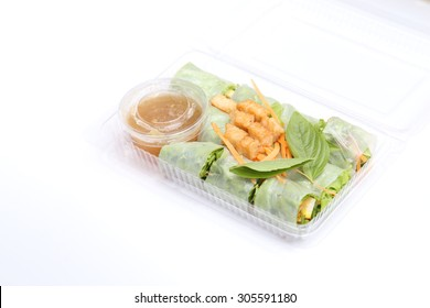 Vietnamese vegetable roll with dip sauce in plastic box