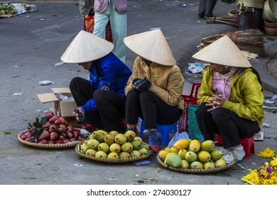 Vietnamese vendors selling fruit and vegetables at Dalat city market, Vietnam