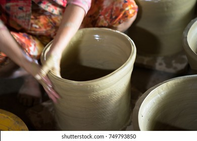 Vietnamese woman hands making clay pots - pottery product by hands in Hon Dat district, Kien Giang province, Mekong delta, South Vietnam