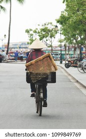 vietnamese woman with hat on bicycle, vintage style