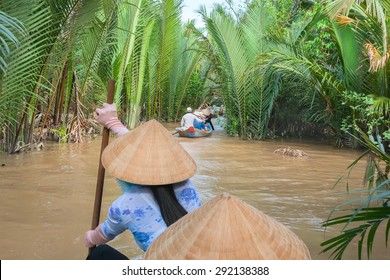 Vietnamese woman paddling in the Mekong River