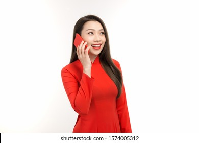 Vietnamese woman talking on cell phone during Lunar new year (Tet holiday)