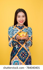 Vietnamese woman traditional festival costume Ao Dai. Tet holiday. Lunar New Year. Text mean rich.