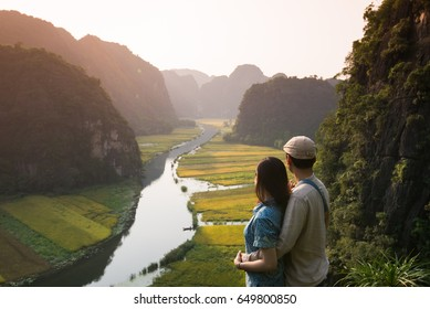 Vietnamese young couple in the famous spot in Tam Coc, Ninh Binh, Vietnam