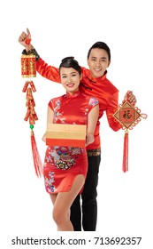 Vietnamese young couple holding attributes of Chinese New Year