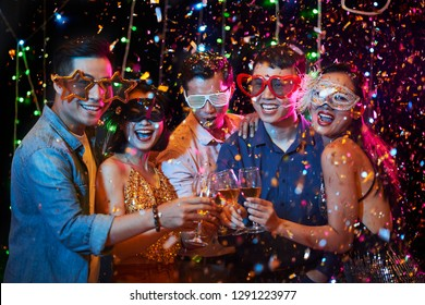 Vietnamese young people having fun at birthday party in night club