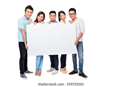 Vietnamese young people holding large empty board