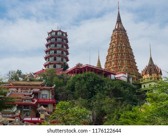 The Vietnamse  stupa at Tham Khao Noi temple and Thai stupa at Wat Tham Sua  or Tiger Cave Temple located adjacent to one another but in separate compounds in Kanchanaburi Province, Thailand