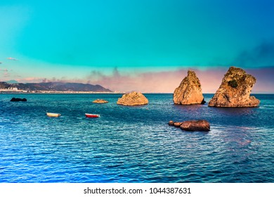 Vietri sul Mare - where Amalfi coast begins. Picturesque summer seascape with 3 rocks on water and mountains. Italy