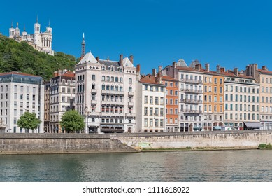 Vieux-Lyon, colorful houses in the center, on the river Saone, with the Fourviere cathedral in background