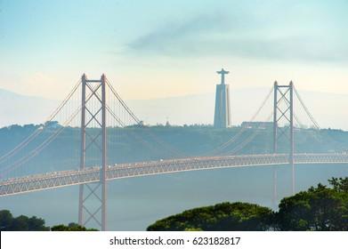 View of 25 April bridge and Christ the Kingmonument. Lisbon, Portugal