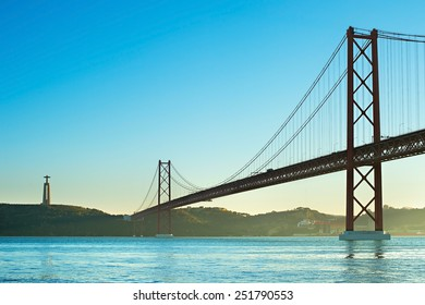 View of 25th of April Bridge at sunset in Lisbon, Portugal