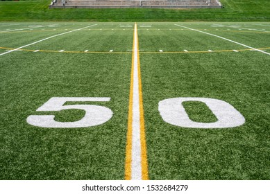 view of 50 yard line from down on the field
