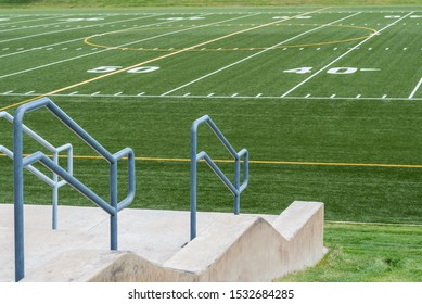 view of 50 yard line of high school football field from the stands