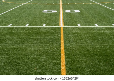 view of 50 yard line from sideline of football field