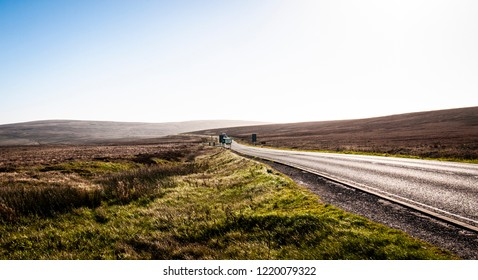 View of the A537 road in the Peak District national park between Buxton and Macclesfield in Derbyshire, England. Taken on a sunny day with blue skies.