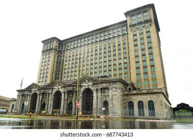 View of the abandoned Michigan Central Station reflected in the rain-washed streets of Detroit, United States.