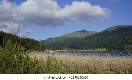 View of Abant Lake (Abant Golu). Landscape of an mountain lake in front of mountain range.  Glorious lake landscape. The collaboration of blue and green. Multiple colors and amazing lake scenery.