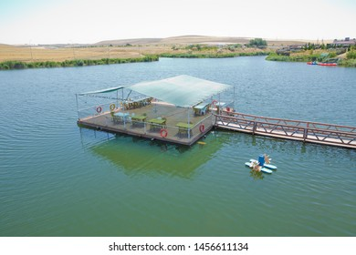 View of Abant Lake ( Golu). Landscape of an mountain lake in front of mountain range. Glorious lake landscape. The collaboration of blue and green. Restaurant and bridge in the middle of the lake