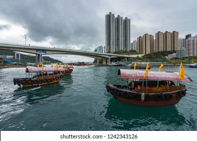 View of Aberdeen harbor in a overcast day with sampans, a traditional chinese wooden boats. Aberdeen, Hong Kong Island, Hong Kong, January 2018