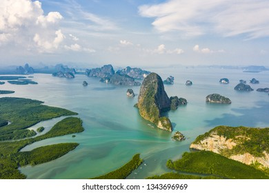 View from above, aerial view of the beautiful Phang Nga Bay (Ao Phang Nga National Park) with the sheer limestone karsts that jut vertically out of the emerald-green water, Thailand.
