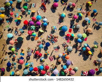 View from above beach colored sunshades umbrellas portugal crowded Mediterranean