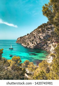 View from above of the beautiful Cala Blanca, Andratx with a turquoise waters  and spanish nature landscape with blue bright summer sky. Mallorca, Balearic Islands