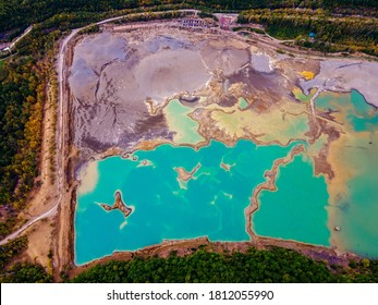 View from above. Blue waters of the former tailing dump in the village of Kavalerovo. Khrustalnensky ore mining and processing plant