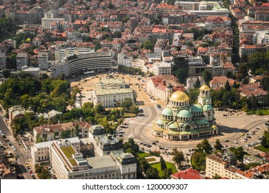View from above to the center of Sofia City - St.Alexander Nevsky Cathedral and Parliament. View from airplane