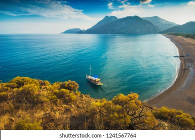 View from above to Cirali beach and Olimpos mountain in a sunset light. Kemer, Antalya, Mediterranean region, Turkey, Lycia.