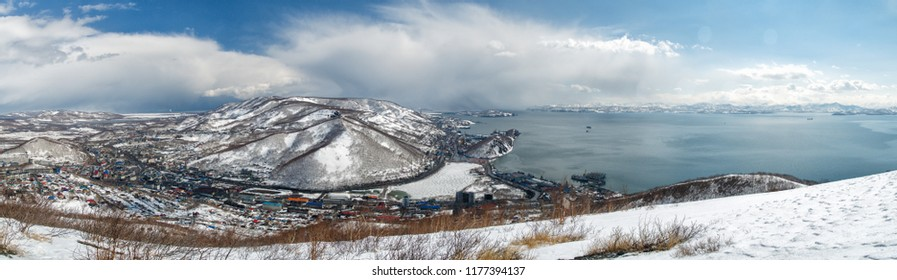 View from above to the city of Petropavlovsk-Kamchatsky and Avchinskaya Bay in winter in sunny weather