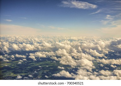 View from above the clouds. Flying over clouds in plane. Over clouds view.