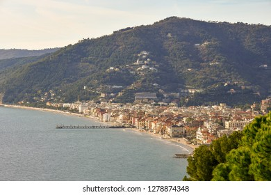 View from above of the coastal city of Alassio with the beach and the pier, Liguria, Italy