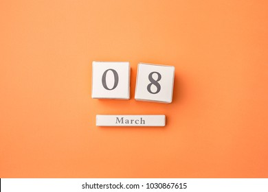 View from above with copy space. Background for woman day, 8 March. Orange table. Woman and stilish workplace. 8 March and Women's Day concept.