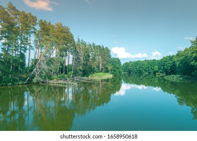 View from above of countryside and river on a sunny day. Nature landscape with beautiful sky. Summertime