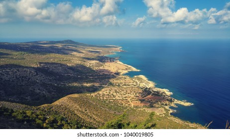 View from above to the Cyprus island sea coast with blue water and lagoons. Akamas cape landscape. Natural seasonal summer vacation background.