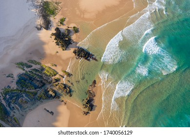 View from above of empty beach with rocks. Seaside vacation turism. Holidays by the beach