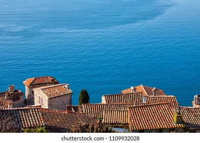 View above Eze village to big blue of Mediterranean Sea in France, houses with tiled roofs on French Riviera, Provence Alpes Cote d'Azur