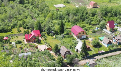 View from above to garden plots with houses and garden beds