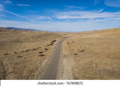View from above of gravel road in central California desert wilderness.