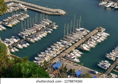 View from above of the harbor of Alassio, with docked boats, Liguria, Italy