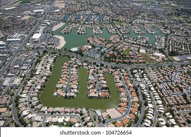 View from above of a man made lake housing community in the desert