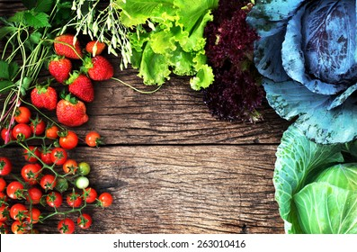 View from above of mix  vegetable and fruit on wooden background with space for text, clean eating food