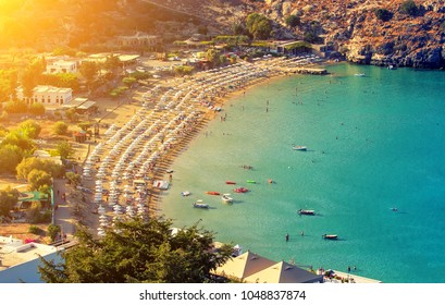 View from above ofmain beach in Lindos, Rhodes, one of the Dodecanese Islands in the Aegean Sea, Greece.
