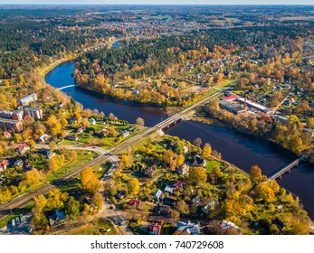 The View from Above of The Ogre River, Bridges and Houses in the Autumn Time, Ogre, Latvia