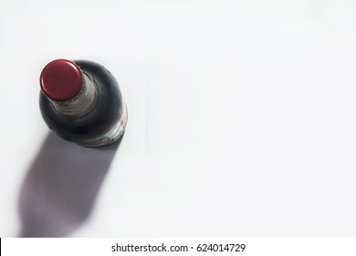 view from above on beer bottle with red cap