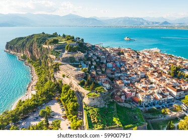 View from above on Nafplio city in Greece with port, Bourtzi fortress and blue Mediterranean sea soft focus