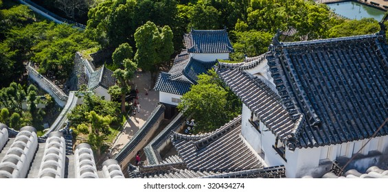View from above on the tiled roofs of White Heron Castle in Himeji, Hyogo Prefecture, Honshu Island, Japan
