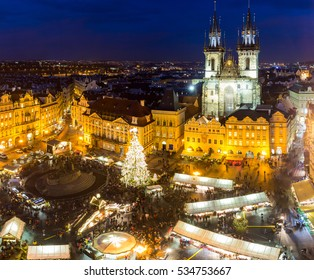 View from above on traditional Christmas market at Old Town Square illuminated and decorated for holidays in Prague, capital of Czech Republic.