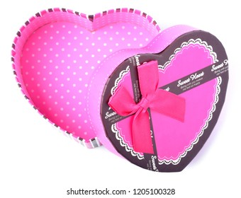 View from above of open empty pink romantic heart-shaped gift box with ribbon isolated on a white background
